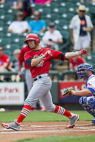 Memphis Redbirds outfielder Randall Grichuk #21 follows through on his swing during the Pacific Coast League baseball game against the Round Rock Express on April 27, 2014 at the Dell Diamond in Round Rock, Texas. The Express defeated the Redbirds 6-2. (Andrew Woolley/Four Seam Images)