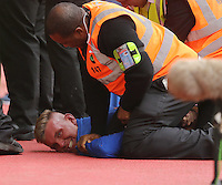 Pictured: A Crystal Palace supporter is taken away by force by stadium stewards<br /> Re: Premier League match between Crystal Palace and Swansea City at Selhurst Park on Sunday 24 May 2015 in London, England, UK