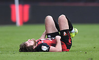 13th March 2021; Vitality Stadium, Bournemouth, Dorset, England; English Football League Championship Football, Bournemouth Athletic versus Barnsley; Ben Pearson of Bournemouth lies injured on the pitch