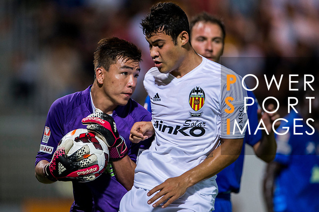 (R) Vinicius Araujo of Valencia CF competes for the ball with (L) Hing Kit Leung of BC Ranger FC during LFP World Challenge 2014 between Valencia CF vs BC Rangers FC on May 28, 2014 at the Mongkok Stadium in Hong Kong, China. Photo by Victor Fraile / Power Sport Images