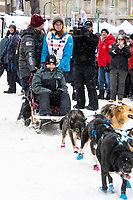 Matthew Failor and team leave the ceremonial start line with an Iditarider and handler at 4th Avenue and D street in downtown Anchorage, Alaska on Saturday March 7th during the 2020 Iditarod race. Photo copyright by Cathy Hart Photography.com