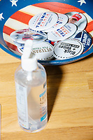 """2020 Trump/Pence campaign buttons including one reading """"Black Voices for Trump"""" lay in an American-flag-themed bowl in the office of the New Hampshire Republican State Committee in Concord, New Hampshire, on Wed., Sept. 16, 2020."""