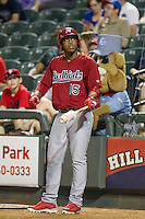 Memphis Redbirds outfielder Oscar Taveras #15 on deck during the Pacific Coast League baseball game against the Round Rock Express on April 24, 2014 at the Dell Diamond in Round Rock, Texas. The Express defeated the Redbirds 6-2. (Andrew Woolley/Four Seam Images)
