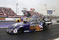 Apr 27, 2014; Baytown, TX, USA; NHRA funny car driver Jack Beckman (near lane) races alongside Ron Capps during the Spring Nationals at Royal Purple Raceway. Mandatory Credit: Mark J. Rebilas-