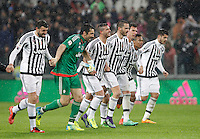 Calcio, Serie A: Juventus vs Inter. Torino, Juventus Stadium, 28 February 2016.<br /> Juventus' players, from left, Andrea Barzagli, Gianluigi Buffon, Stefano Sturaro, Leonardo Bonucci, Mario Mandzukic, Alex Sandro and Alvaro Morata greet fans at the end of the Italian Serie A football match between Juventus and Inter at Turin's Juventus Stadium, 28 February 2016. Juventus won 2-0.<br /> UPDATE IMAGES PRESS/Isabella Bonotto