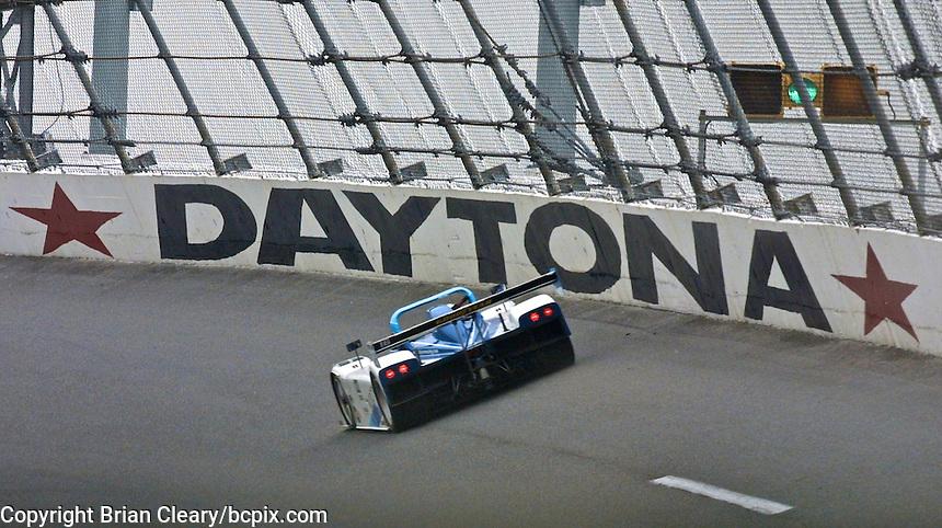 An SRP Riley and Scott prototype race car speeds past a Daytona sign during the Rolex 24 at Daytona, Daytona INternational Speedway, Daytona Beach, FL, February 4, 2001.  (Photo by Brian Cleary/www.bcpix.com)