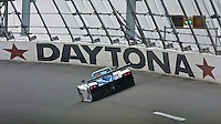 An SRP Riley and Scott prototype race car speeds past a Daytona sign during the Rolex 24 at Daytona, Daytona INternational Speedway, Daytona Beach, FL, February 4, 2001.  (Photo by Brian Cleary/www.bcpix.com)