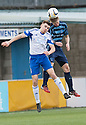 Peterhead's Jamie Redman and Forfar's Michael Travis challenge for the high ball.