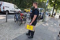 Kundgebung am Montag den 1. Juni 2019 vor der italienischen Botschaft in Berlin fuer die Freilassung der am 29. Juni in Italien verhafteten Seawatch Kapitaenin Carola Rakete. Die Kapitaenin der Seenotrettungsorganisation war am 29. Juni gegen den Willen der italienischen Regierung auf der Mittelmeerinsel Lampedusa, mit 40 aus Seenot geretteten Fluechtlingen, im Hafen angelegt und war daraufhin festgenommen worden.<br /> Im Bild: Ein Polizeibeamter traegt einem Kundgebungsteilnehmer ein verlorenes Protestschild hinterher.<br /> 1.7.2019, Berlin<br /> Copyright: Christian-Ditsch.de<br /> [Inhaltsveraendernde Manipulation des Fotos nur nach ausdruecklicher Genehmigung des Fotografen. Vereinbarungen ueber Abtretung von Persoenlichkeitsrechten/Model Release der abgebildeten Person/Personen liegen nicht vor. NO MODEL RELEASE! Nur fuer Redaktionelle Zwecke. Don't publish without copyright Christian-Ditsch.de, Veroeffentlichung nur mit Fotografennennung, sowie gegen Honorar, MwSt. und Beleg. Konto: I N G - D i B a, IBAN DE58500105175400192269, BIC INGDDEFFXXX, Kontakt: post@christian-ditsch.de<br /> Bei der Bearbeitung der Dateiinformationen darf die Urheberkennzeichnung in den EXIF- und  IPTC-Daten nicht entfernt werden, diese sind in digitalen Medien nach §95c UrhG rechtlich geschuetzt. Der Urhebervermerk wird gemaess §13 UrhG verlangt.]