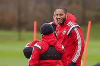SWANSEA, WALES - JANUARY 28:  Ashley Williams laughs with Leon Britton of Swansea City before training  on January 28, 2015 in Swansea, Wales.