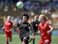 Eriko Arakawa (left) and Becky Sauerbrunn (22) chase down the ball. FC Gold Pride defeated Washington Freedom 3-2 at Buck Shaw Stadium in Santa Clara, California on August 1, 2009.