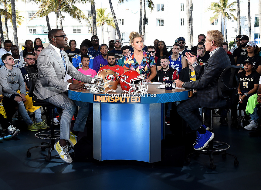 """MIAMI BEACH, FL - JANUARY 29: Shannon Sharpe, Jenny Taft, and Skip Bayless on the set of """"Skip & Shannon: Undisputed"""" on the Fox Sports South Beach studio during Super Bowl LIV week on January 29, 2020 in Miami Beach, Florida. (Photo by Frank Micelotta/Fox Sports/PictureGroup)"""