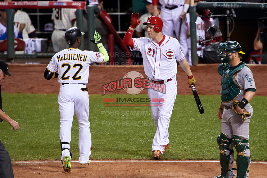 Pittsburgh Pirates Andrew McCutchen high fives Cincinnati Reds Todd Frazier after hitting a home run during the MLB All-Star Game on July 14, 2015 at Great American Ball Park in Cincinnati, Ohio.  (Mike Janes/Four Seam Images)