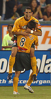 Los Angeles Galaxy's Herculez Gomez gets a hug from teammate (8) Guillermo Gonzalez after scoring a goal against FC Dallas in the first half at the Home Depot Center in Carson, CA on Saturday night, October 1, 2005..(Matt A. Brown/ISI)