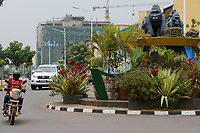 RWANDA, Kigali, city center with banks and insurance companies, roundabout with mountain gorilla statue , behind chinese construction site / RUANDA, Kigali, Stadtzentrum, Banken Buero und Versicherungstower, Berggorilla Skulptur auf Verkehrsinsel