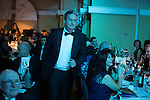 © Joel Goodman - 07973 332324 . 05/03/2015 .  Midland Hotel , Manchester , UK . Winner LHS walks to the stage to collect their award . Medium Law Firm of the Year . The Manchester Legal Awards 2015 . Photo credit : Joel Goodman