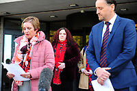Pictured: Family members watch on as DC Emma Warner-Brindley (left) reads a statement on behalf of the family of John 'Jack' Williams, outside Swansea Crown Court, in Wales, UK. Thursday 01 November 2018<br /> Re: Jonathan Donne, a convicted killer who murdered 67 year old John 'Jack' Williams after robbing him in his own home has been jailed for life by Swansea Crown Court.<br /> Donne, 42, from Swansea, was found guilty of the robbery and murder.<br /> Mr Williams was tied up and battered in the living room of his Swansea home in March 2018 because Donne thought he had a large quantity of drugs and money.<br /> He was told he must serve at least 31 years before he can be released from prison.<br /> He was also given a 15 year sentence for robbery, which will be served concurrently.<br /> Donne went to Mr Williams's house because he needed money where he hit and tied Mr Williams up, but insisted he was alive when he left.<br /> Mr Williams suffered serious brain and head injuries in the attack.<br /> The victim had been growing and selling cannabis and Donne thought he would have drugs and cash he could steal.