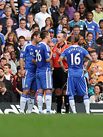 Pictured: John Terry of Chelsea (2ndL) is protesting to referee Mike Dean (3rd L) for the sending off of Fernando Torres for his foul against Mark Gower of Swansea. Saturday 17 September 2011<br /> Re: Premiership football Chelsea FC v Swansea City FC at the Stamford Bridge Stadium, London.