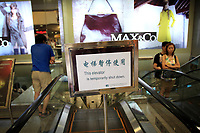 CHINA. A sign in a shopping centre in central Beijing. The rise in use of English in China is evident on the streets of Beijing where store-fronts, billboards and clothes all sport English words and phrases. 2009