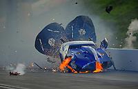 Jun. 18, 2011; Bristol, TN, USA: NHRA pro mod driver Roger Burgess loses control and crashes after winning his first round race during eliminations at the Thunder Valley Nationals at Bristol Dragway. Mandatory Credit: Mark J. Rebilas-