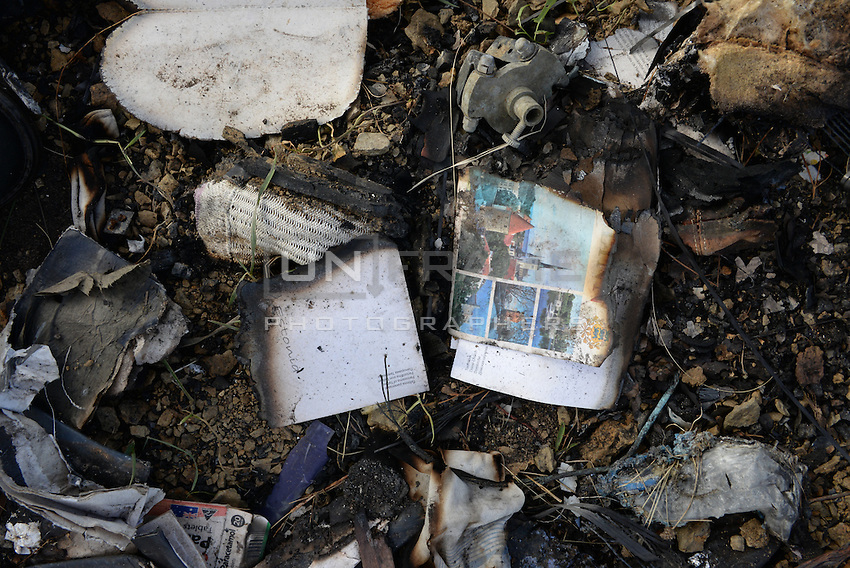 Belongings of 289 passengers on Malaysia MH17 crash site, scattered across fields covering an area of 20 sq km. Near Hrabove, Donetsk Oblast, Ukraine. Nov. 10, 2014