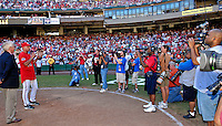 23 September 2007: Washington Nationals Manager Manny Acta (in red, left) address the fans in a post-game ceremony removing the plate from RFK Stadium after the final home game for the Nationals in 2007. The game also marked the very last professional baseball game at RFK Stadium and was played against the Philadelphia Phillies at Robert F. Kennedy Memorial Stadium in Washington, DC. The Nationals defeated the visiting Phillies 5-3 to close out the 2007 home season. The Nationals will open up the 2008 season at Nationals Park, their new facility currently under construction.. .Mandatory Photo Credit: Ed Wolfstein Photo
