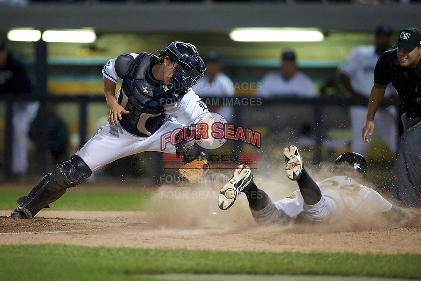 West Michigan Whitecaps Zach Maggard #27 attempts to tag Drew Vettleson #24 sliding in during a game against the Bowling Green Hot Rods at Fifth Third Ballpark on June 26, 2012 in Comstock Park, Michigan.  West Michigan defeated Bowling Green 13-11.  (Mike Janes/Four Seam Images)
