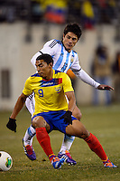 Ecuador midfielder Jefferson Montero (9) is marked by Argentina defender Facundo Roncaglia (13). Argentina and Ecuador played to a 0-0 tie during an international friendly at MetLife Stadium in East Rutherford, NJ, on November 15, 2013.