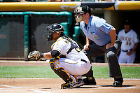 Luis Martinez (20) of the Salt Lake Bees behind the plate with home plate umpire Brandon Misun during the game against the Nashville Sounds at Smith's Ballpark on June 22, 2014 in Salt Lake City, Utah.  (Stephen Smith/Four Seam Images)