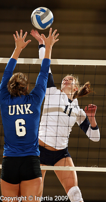 SIOUX FALLS, SD - SEPTEMBER 2:  Brianna Erickson #11 of Augustana looks to get a kill past Jeri Walkowiak #6 of Nebraska-Kearney in the second game of their match Wednesday night at the Elmen Center. (Photo by Dave Eggen/Inertia).