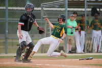 South Vermont Mountaineers Dan Mason (17) slides home safely past catcher Kamdan Bloom during a game against the Edgewood Eagles on March 18, 2019 at Lee County Player Development Complex in Fort Myers, Florida.  South Vermont defeated Edgewood 19-6.  (Mike Janes/Four Seam Images)