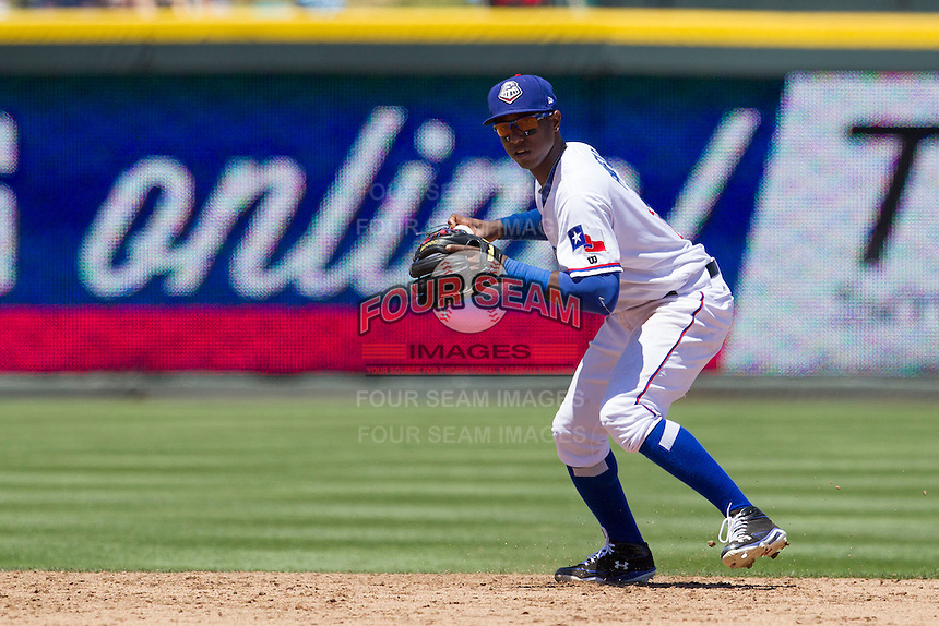 Round Rock shortstop Jurickson Profar (10) prepares to makes a throw to first base against the Nashville Sounds in the Pacific Coast League baseball game on May 5, 2013 at the Dell Diamond in Round Rock, Texas. Round Rock defeated Nashville 5-1. (Andrew Woolley/Four Seam Images).