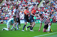 Swansea City's Oli McBurnie celebrates scoring his side's first goal during the Sky Bet Championship match between Sheffield United and Swansea City at Bramall Lane, Sheffield, England, UK. Saturday 04 August 2018