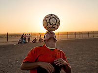 """***WARNING*** RESTRICTED USAGE ---   ***DO NOT USE WITHOUT TALKING TO BECKY FIRST!! PART OF A PROJECT. NO RIGHTS OUTSIDE OF THAT PROJECT. ***  ***            Mohammed Kalf, a player on the """"happiness"""" team. He played in Syria and keeps practicing here in the camp."""