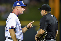 Round Rock Express manager Steve Buechele (22) argues a call with home plate umpire Roberto Ortiz during pacific coast league baseball game, Friday August 14, 2014 in Round Rock, Tex. Reno defeated Round Rock 6-1 to go two up in best of three series. (Mo Khursheed/TFV Media via AP Images)