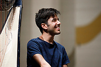 Valerio Lisci from Italy shares a laugh before an orchestra rehearsal for the Final Stage concert at the 11th USA International Harp Competition at Indiana University in Bloomington, Indiana on Friday, July 12, 2019. (Photo by James Brosher)