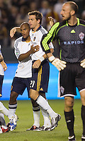 LA's Alan Gordon (center) celebrates his goal with teammate Kyle Patterson (left) while Rapids goalkeeper Preston Burpo (right) looks on. The Colorado Rapids defeated LA 3-2 at Home Depot Center stadium in Carson, California on Saturday April 4, 2009.  .Photo by Michael Janosz/ isiphotos.com