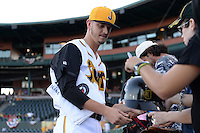 Jacksonville Suns pitcher Justin Nicolino (22) signs autographs before game three of the Southern League Championship Series against the Chattanooga Lookouts on September 12, 2014 at Bragan Field in Jacksonville, Florida.  Jacksonville defeated Chattanooga 6-1 to sweep three games to none.  (Mike Janes/Four Seam Images)
