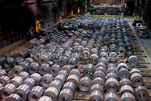 """Dearborn, Michigan<br /> USA<br /> February 15, 2011<br /> <br /> Rolls of steel in the former Ford Rouge Steel Plant completed in 1928 is now owned, run and being renovated and expanded by Russian owner """"Severstal North America"""". This is one of five steel plants owned by Severstal in the United States and they are spending huge sums to convert it into what could be the continent's most efficient automotive steel plant.<br /> <br /> Rouge Steel fell on hard times after Ford Motor Company spun it off in 1989 into an independent steel company. <br /> <br /> After buying the assets of the bankrupt company for USD 280 million, Severstal spent USD 350 million to repair one of the blast furnaces. The company built a new cold-rolling line which converts steel slabs into sheet metal. And it added a galvanizing line which coats sheet metal with zinc for rust-resistant body panels.<br /> <br /> The operation assets and improvements amount to USD 1.4 billion. Add in spending on a new mini mill in Columbus, Mississippi a USD 1.6 billion operation and Severstal has placed a USD 3 billion bet on North America auto industry."""