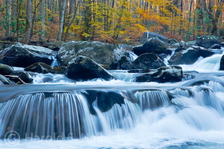 Fall colors reflect in the Tremont River in the Great Smoky Mountains National Park near Townsend, Tennessee.