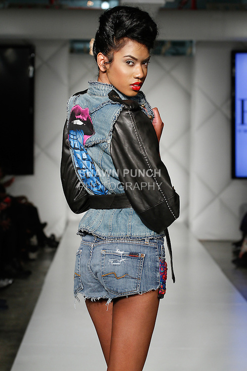 Model walks runway in an outfit from the Born Again Vintage collection by Bridgett Artiste during Fashion Week Brooklyn Fall Winter 2014, Day 1 at Industry City, on March 13, 2014.