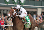 October 04, 2014: Carpe Diem and jockey John Velazquez win the Claiborne Breeders' Futurity Grade 1 $500,000 at Keeneland Racecourse.  Candice Chavez/ESW/CSM
