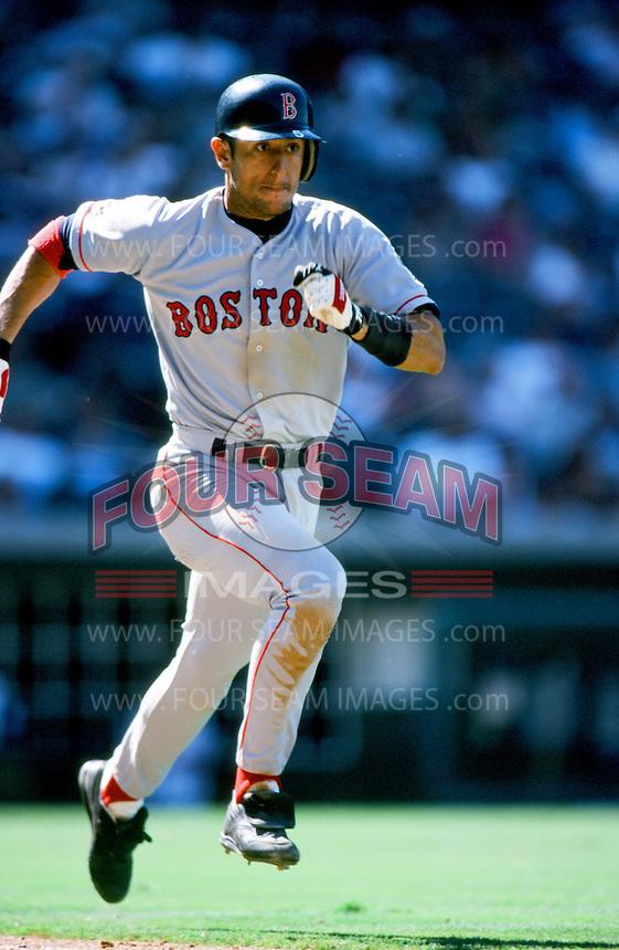 Nomar Garciaparra of the Boston Red Sox runs to first base during a 1999 Major League Baseball season game against the Anaheim Angels in Anaheim, California. (Larry Goren/Four Seam Images)