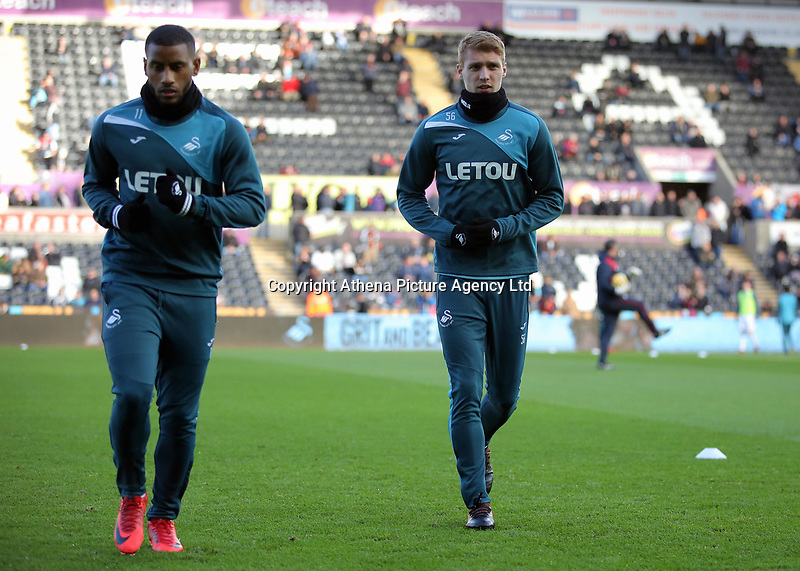 (L-R) Luciano Narsingh and Jay Fulton of Swansea City warm up during the Premier League match between Swansea City and Brighton and Hove Albion at The Liberty Stadium, Swansea, Wales, UK. Saturday 04 November 2017