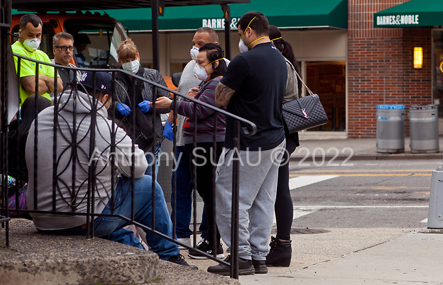 Brooklyn, New York<br /> March 20, 2020<br /> 1:51 PM<br /> <br /> Brooklyn under the coronavirus pandemic. <br /> <br /> People outside the emergency entrance to New York-Presbyterian Brooklyn Methodist Hospital in Park Slope, Brooklyn.
