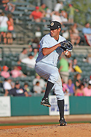 Charleston RiverDogs pitcher Caleb Smith #12 0n the mound during a game against the Augusta GreenJackets  at Joseph P. Riley Jr. Ballpark  on April 13, 2014 in Charleston, South Carolina. Augusta defeated Charleston 2-1. (Robert Gurganus/Four Seam Images)
