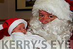 Little Joey Evans at just two weeks old from Cahersiveen on his first visit to see Santa in the Cahersiveen Credit Union on Saturday.