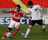 Lasse Christensen (L) of Denmark is challenged by Robin Yalcin of Germany during the UEFA U17 Championships Semi Final match between Denmark and Germany on May 12, 2011 in Novi Sad, Serbia. (Photo by Srdjan Stevanovic/Starsportphoto.com)
