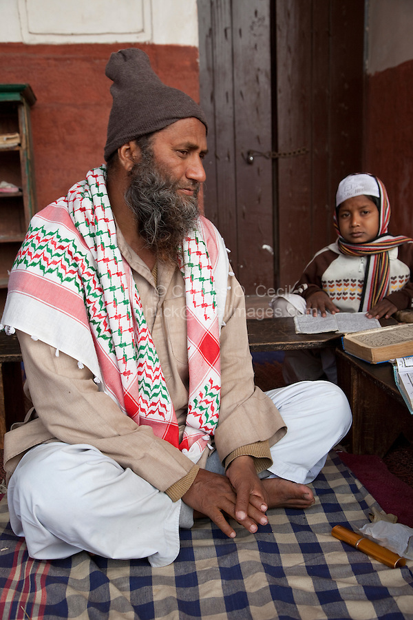 Agra, India.  Imam Hussein Listening to his Students Reading the Koran in the Madrasa of the Jama Masjid (Friday Mosque).
