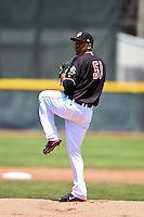 Erie SeaWolves pitcher Wilsen Palacios (51) delivers a warmup pitch during a game against the Akron RubberDucks on May 18, 2014 at Jerry Uht Park in Erie, Pennsylvania.  Akron defeated Erie 2-1.  (Mike Janes/Four Seam Images)